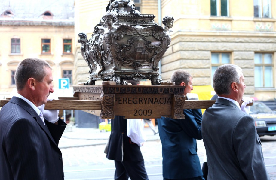 men carrying reliquary with relics on a procession