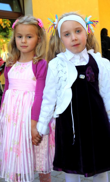 two Catholic child girls near a Church after the Holy Mass, photo 2