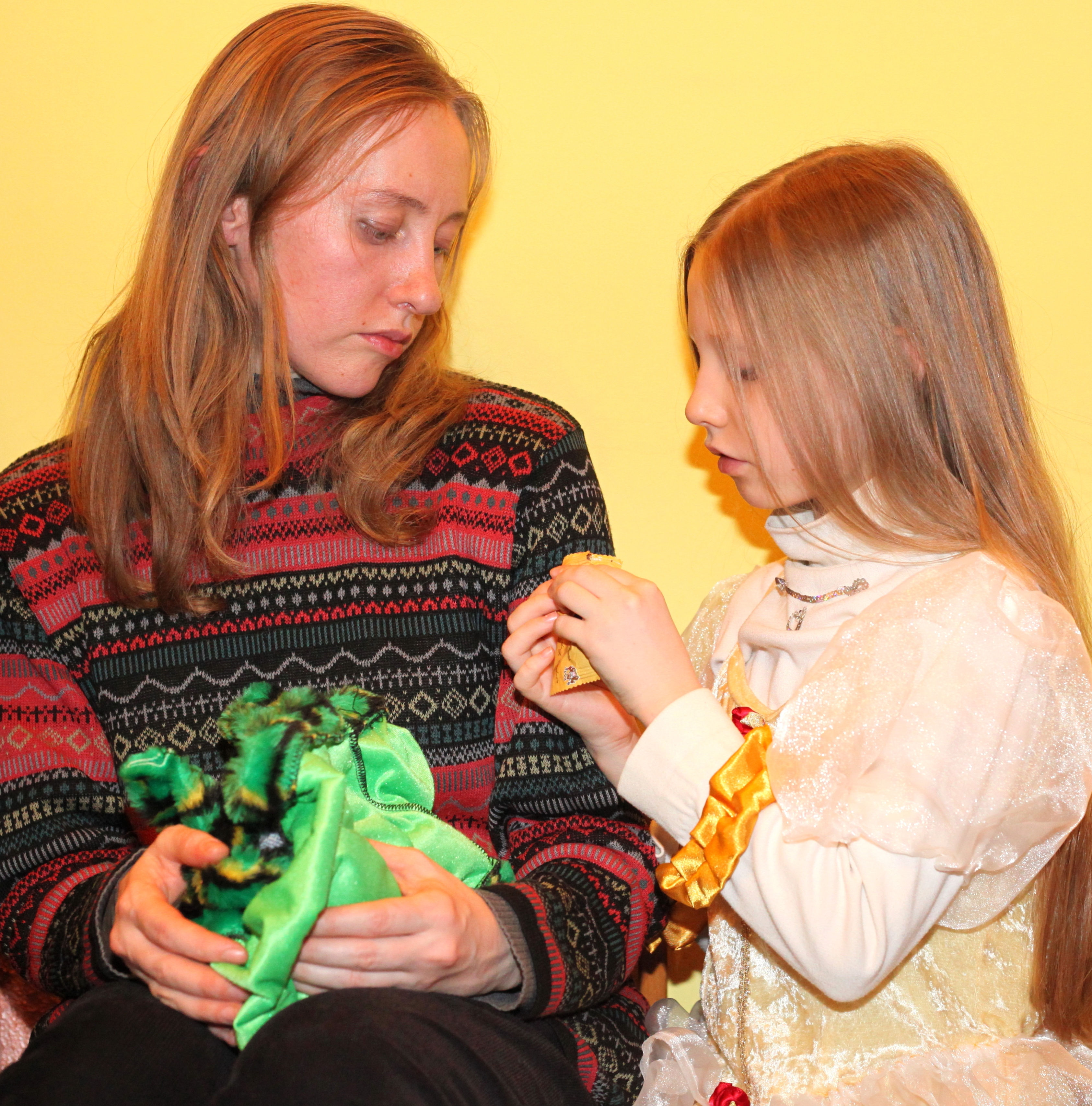 a beautiful blond woman with a beautiful blond girl in a Catholic kindergarten, photo 1