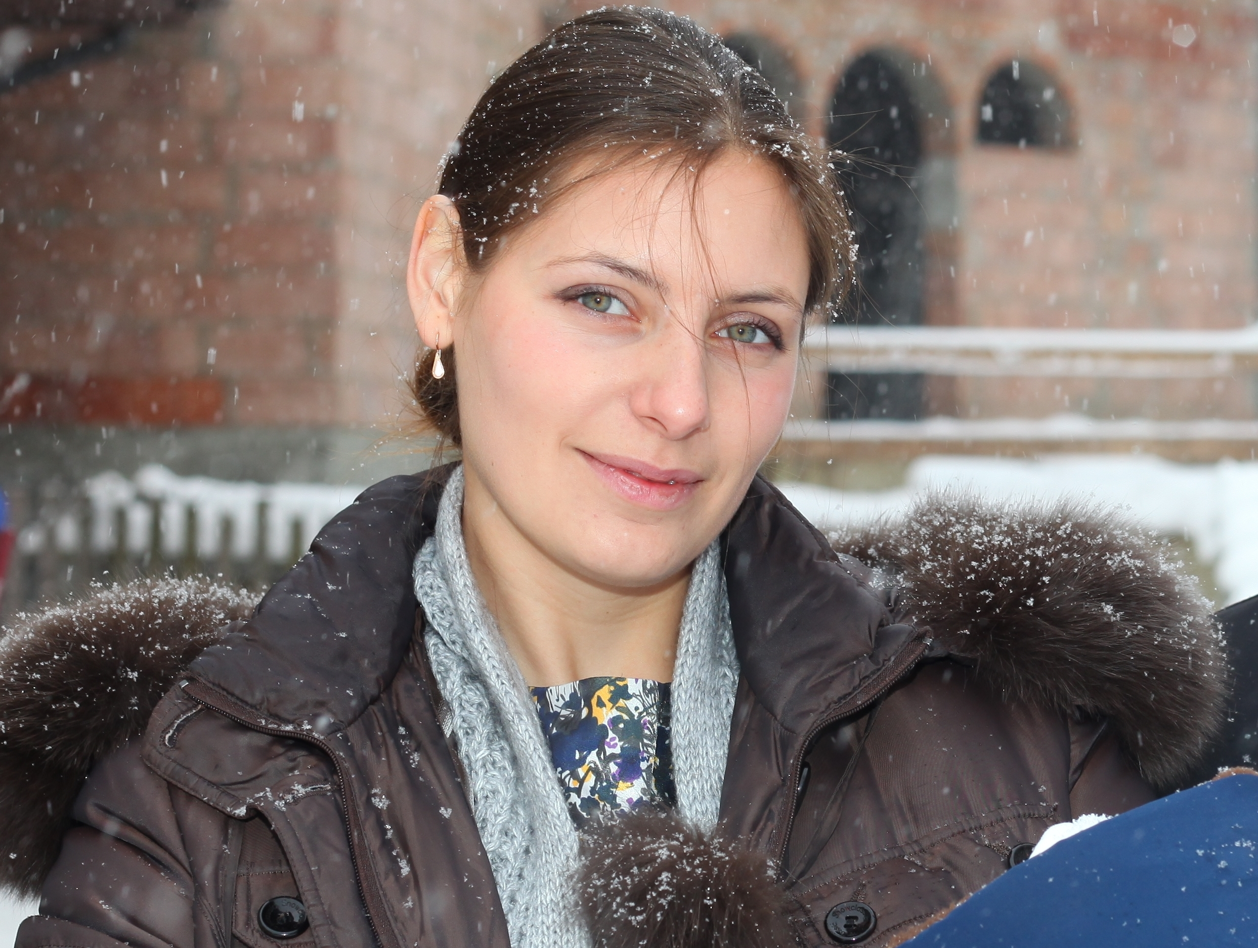 a beautiful Catholic godmother after the baptism of the baby, snowing, photo 7