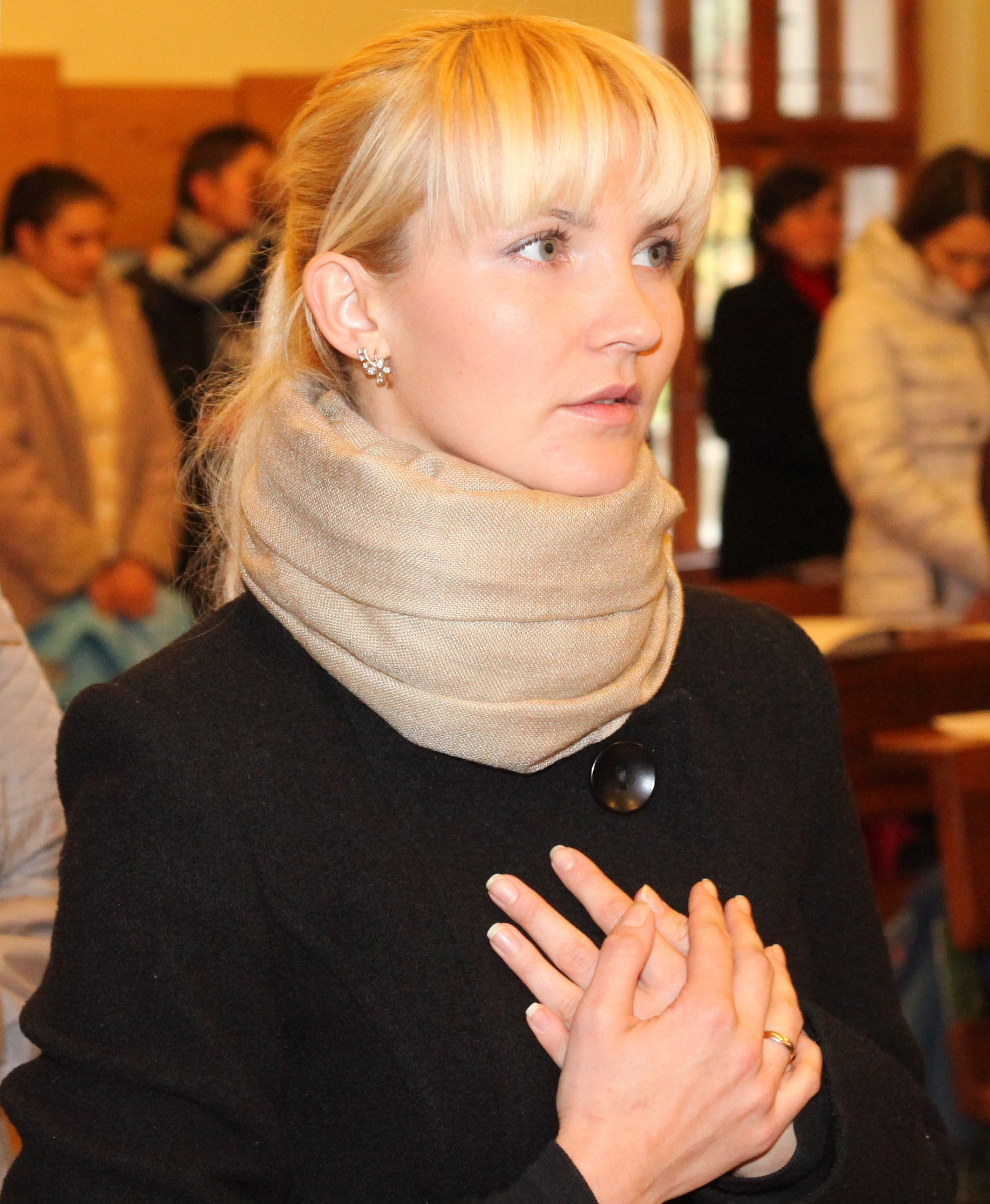 an amazingly tender and charming beautiful young blond Catholic woman in a Church, photo 3
