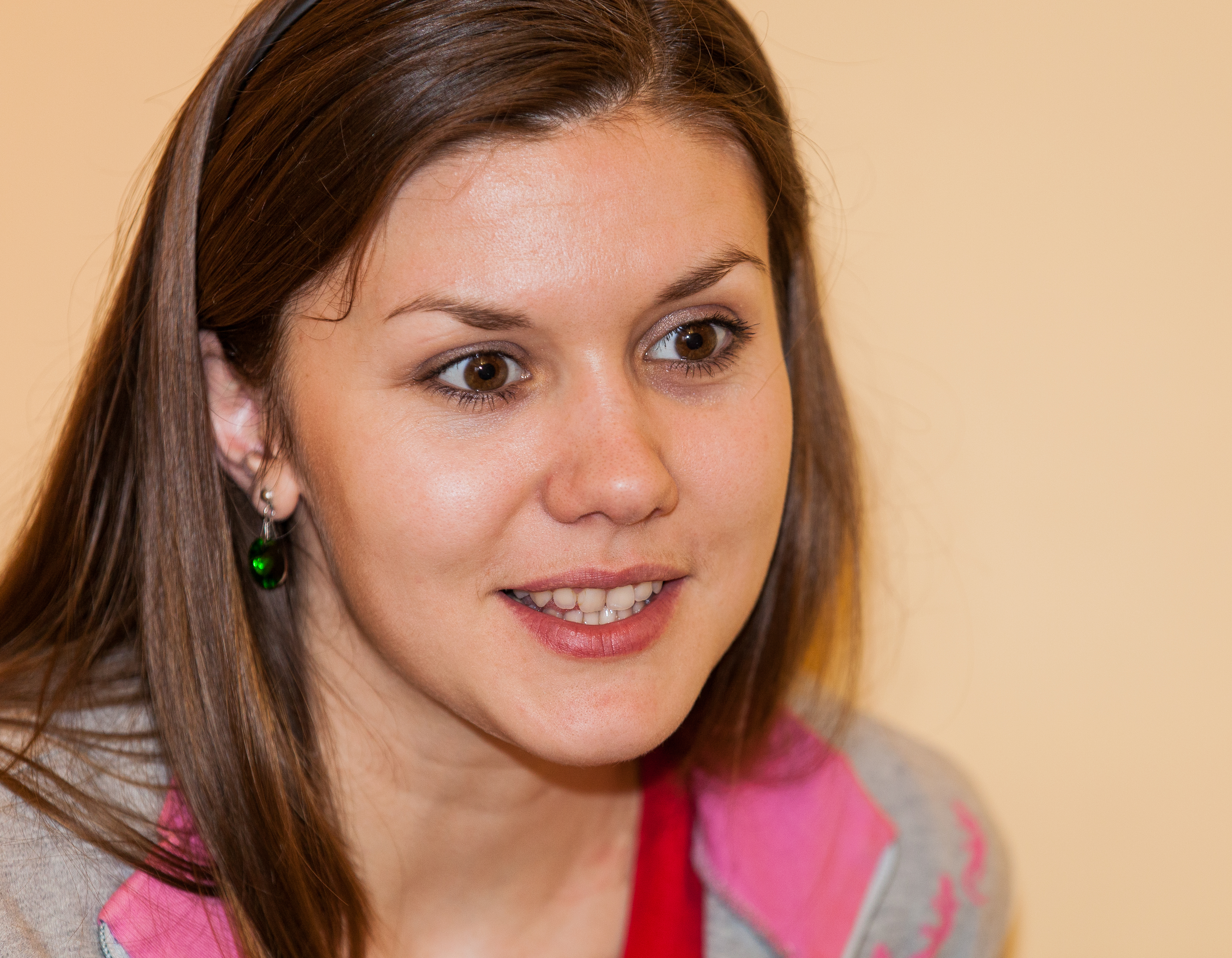 a brunette Catholic young cute woman photographed in April 2014, picture 1/13