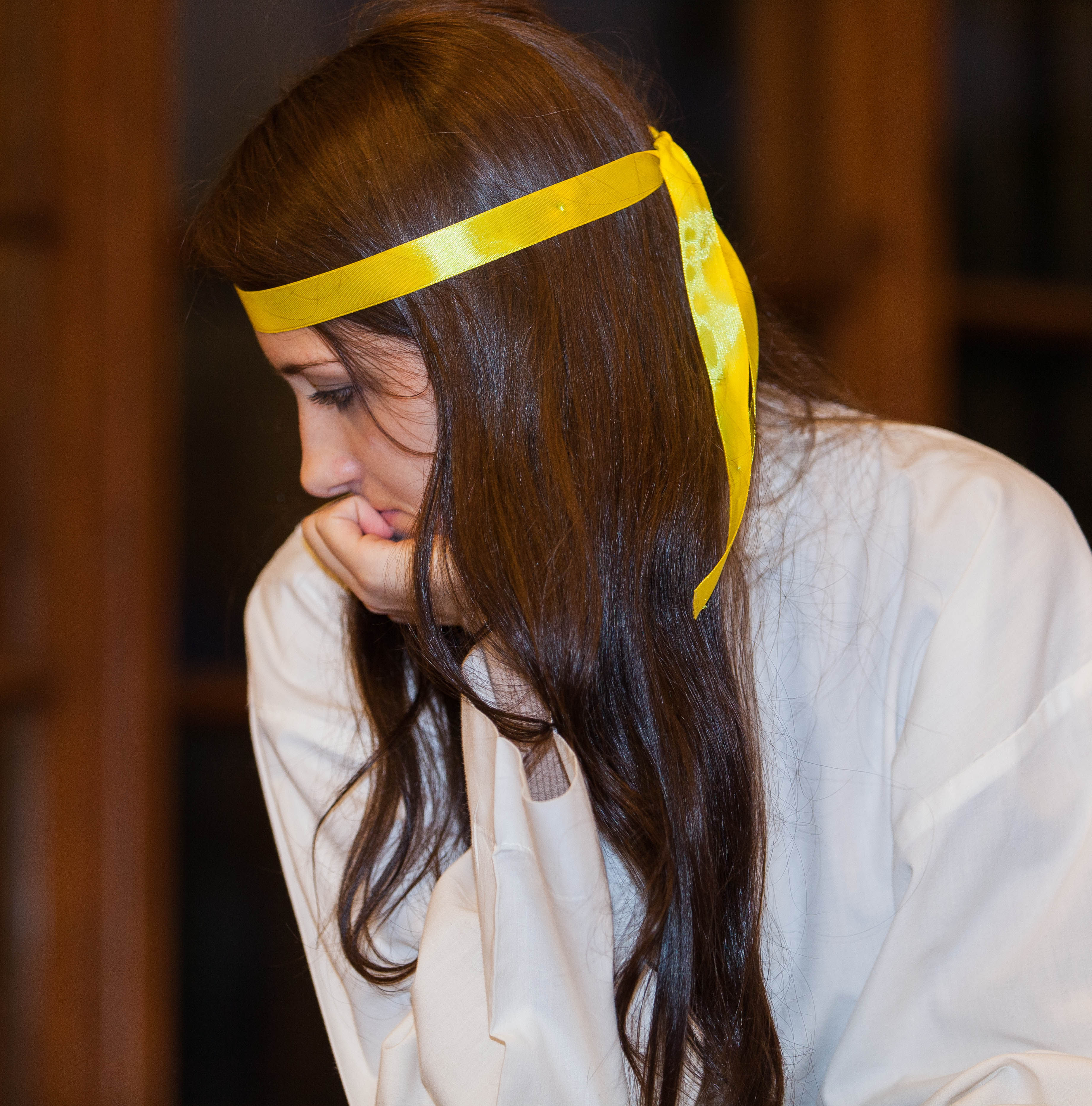 a young brunette Catholic woman in a church photographed in December 2013, picture 6