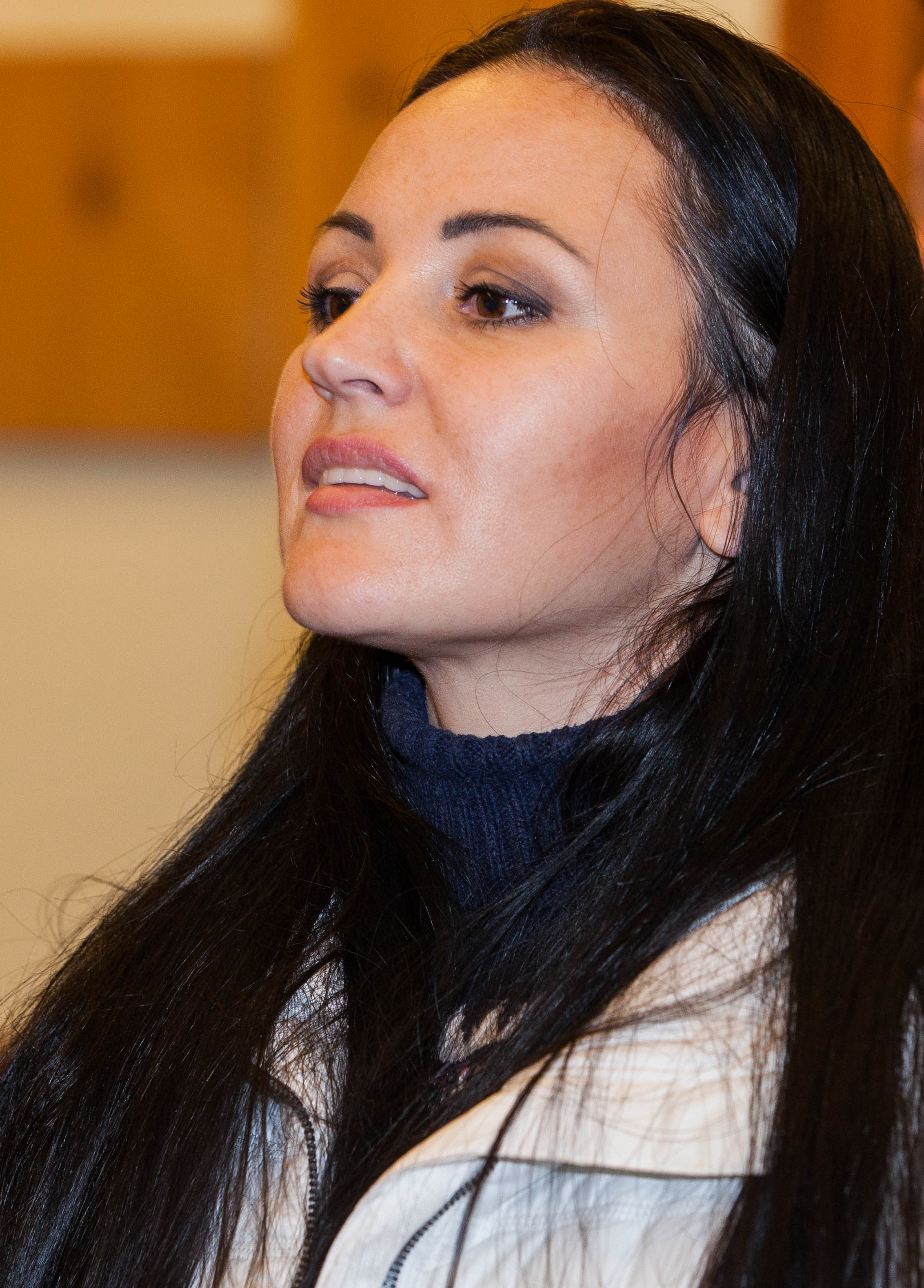 a young brunette woman photographed in a Catholic chapel in December 2013, picture 1/2