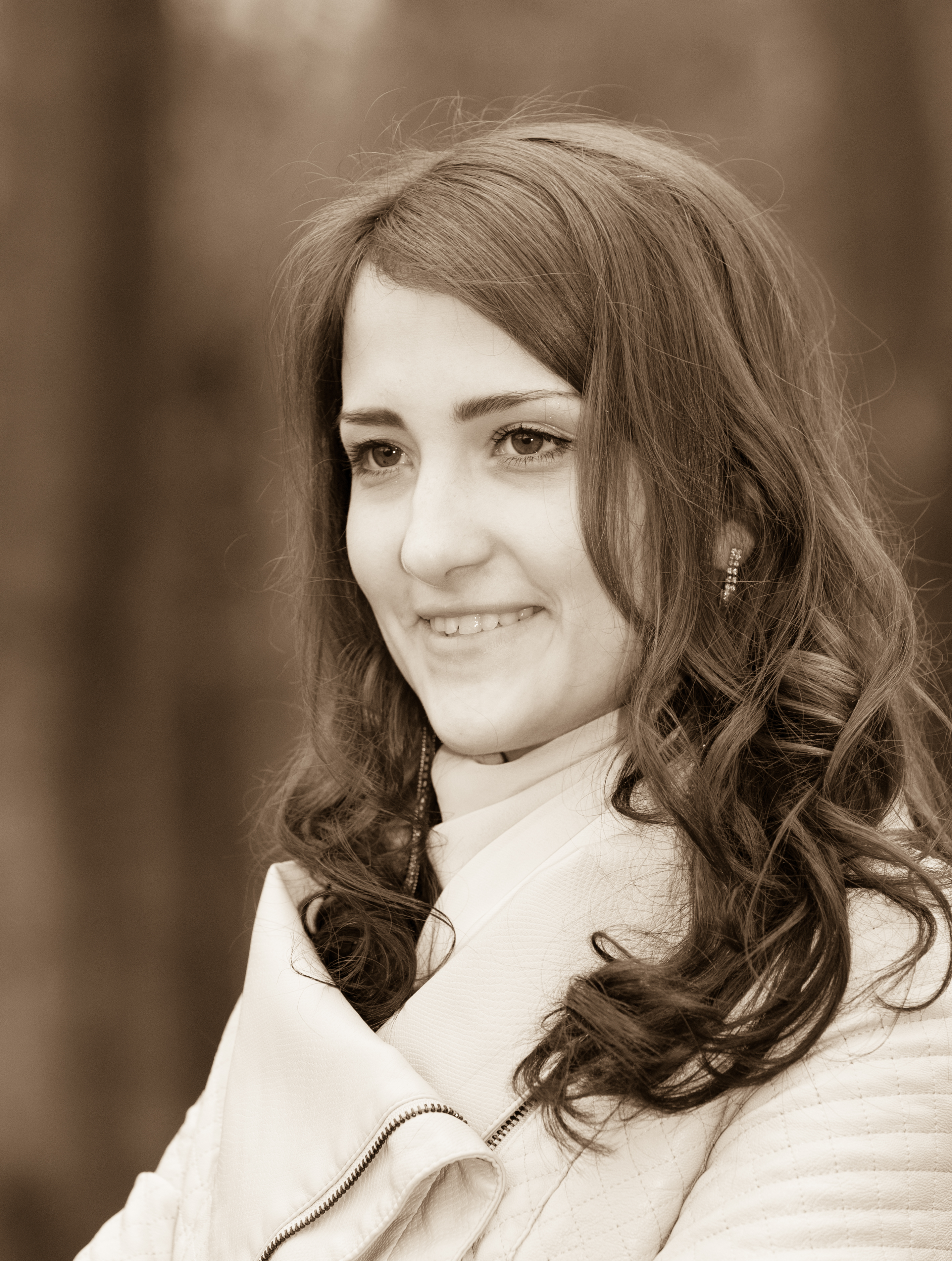 a brunette Catholic amazingly beautiful woman photographed in April 2014, black and white sepia tone, picture 9/15