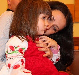 an amazingly attractive charming beautiful young brunette Catholic woman with her cute charming daughter in a Church, photo 6