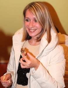a smiling beautiful young fair-haired charming woman in a Catholic Church, photo 4