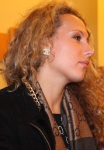 a beautiful young curly fair-haired woman in a Catholic Church, photo 2
