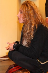 a beautiful young curly fair-haired woman in a Catholic Church, photo 3
