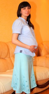a Catholic woman on her 7-th month of pregnancy, picture 1