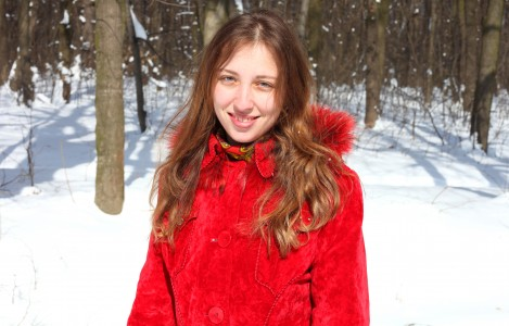 a charming beautiful attractive young Catholic woman in a snowy forest, photo 2