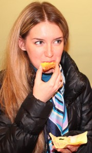 a charming beautiful young fair-haired long-haired woman eating something, photo 7