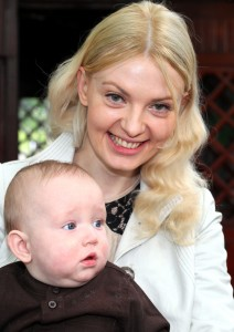 a pretty blond woman with her baby son photographed in June 2013