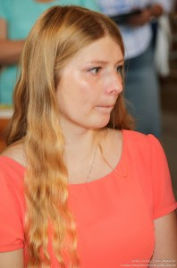 a young blond woman in a Catholic church in July 2016, picture 1