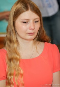 a young blond woman in a Catholic church in July 2016, picture 2