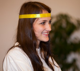 a young brunette Catholic woman in a church photographed in December 2013, picture 11