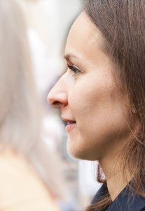 a profile of a young brunette pretty woman photographed in May 2014, picture 2/9