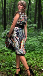 a young Catholic woman wearing a colorful dress in a forest in June 2013, portrait 6/9