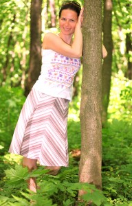 an amazingly feminine and beautiful brunette Catholic woman in a forest in May 2013, picture 3