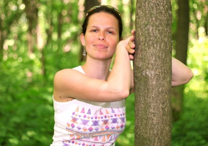 a beautiful brunette Catholic woman near a tree in May 2013