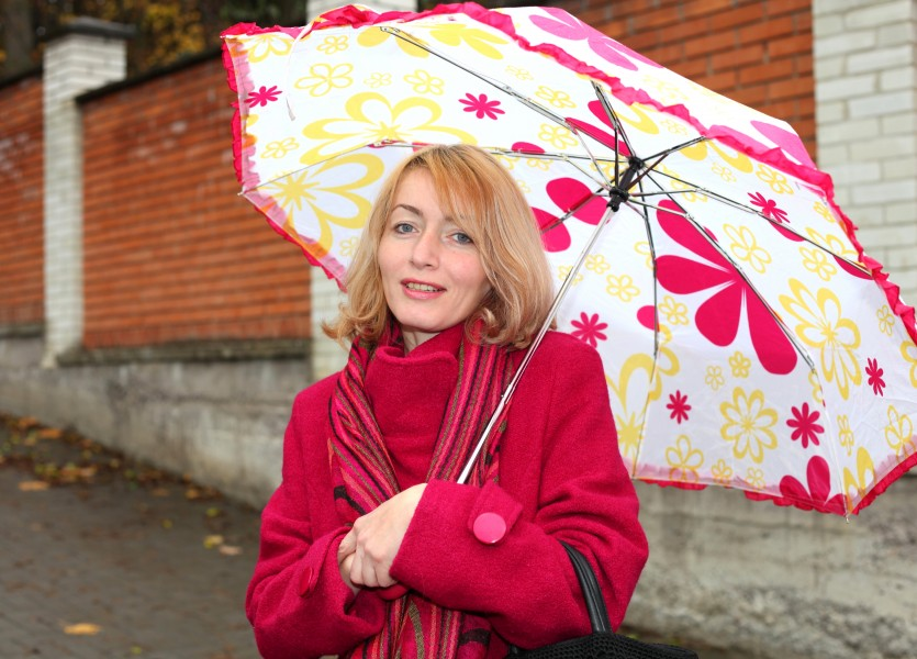 a beautiful Catholic woman with an umbrella, photo 4
