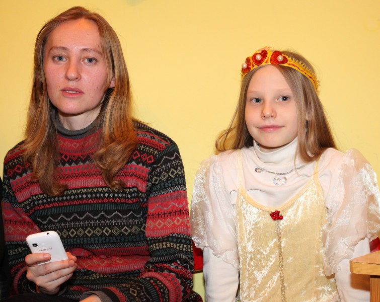a beautiful blond woman with a beautiful blond girl in a Catholic kindergarten, photo 2