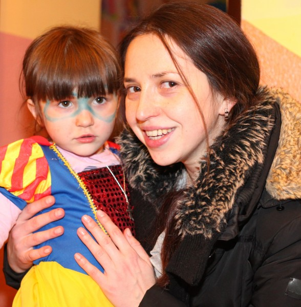 a beautiful brunette Catholic woman with her cute daughter in a Catholic kindergarten, photo 1