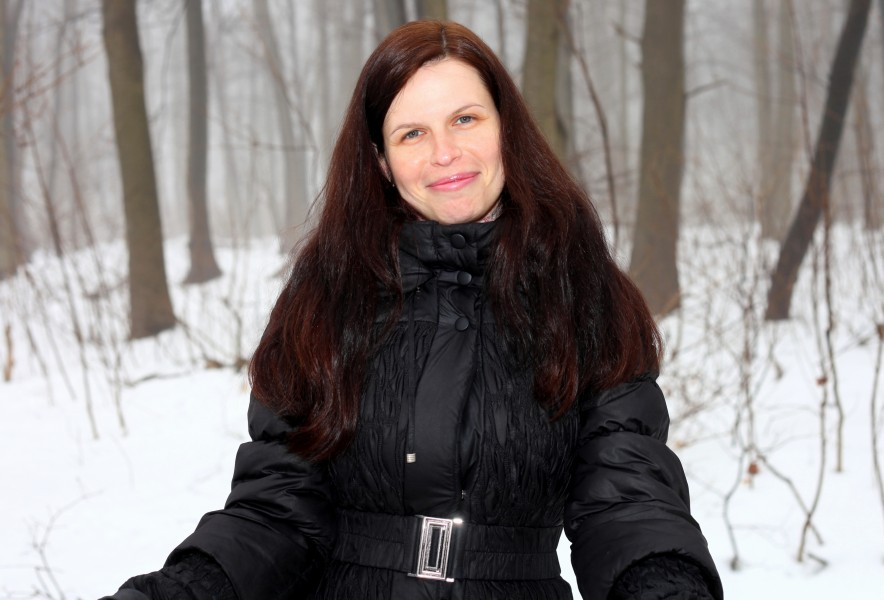 an amazingly beautiful charming Catholic woman in a forest, picture 12
