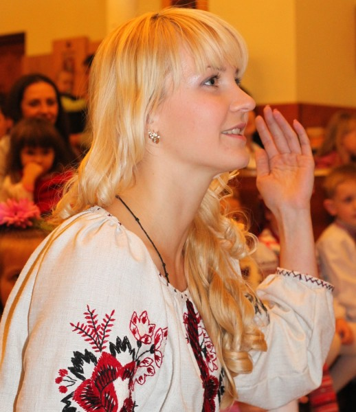 an amazingly tender, charming, feminine, beautiful young blond Catholic woman in a Church, photo 10