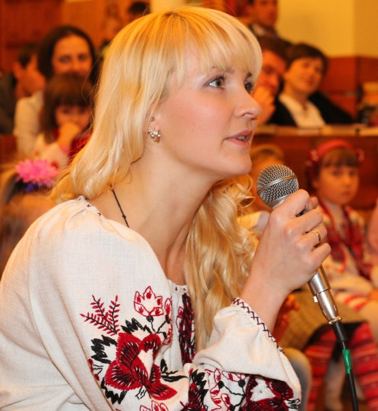 an amazingly tender, charming, feminine, beautiful young blond Catholic woman in a Church, photo 12