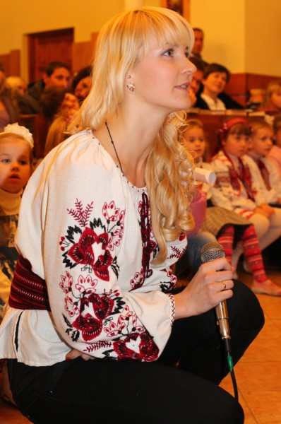 an amazingly charming and tender beautiful young blond Catholic woman in a Church, photo 13