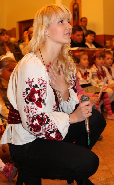 an amazingly charming and tender beautiful young blond Catholic woman in a Church, photo 14