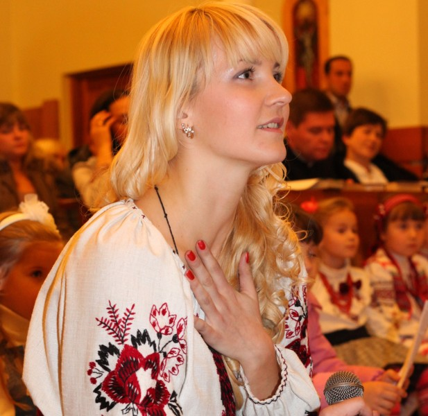 an amazingly charming and tender beautiful young blond Catholic woman in a Church, photo 16