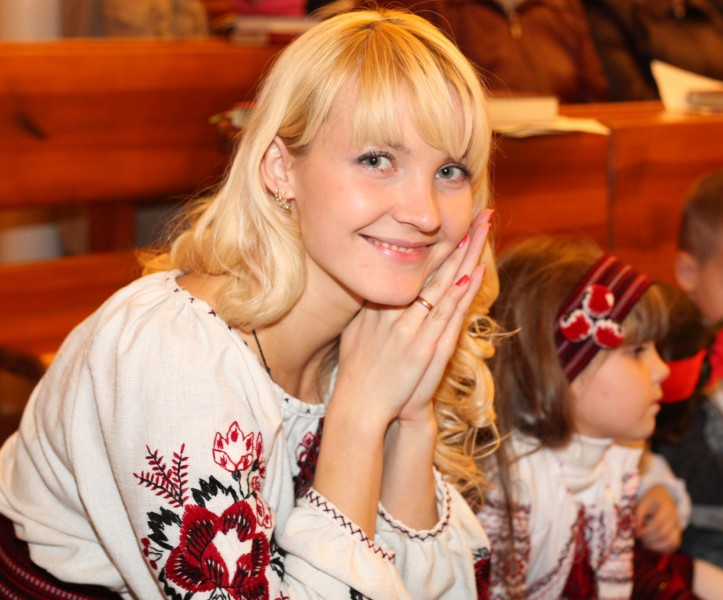 an amazingly tender and charming beautiful young blond smiling Catholic woman in a Church, photo 19