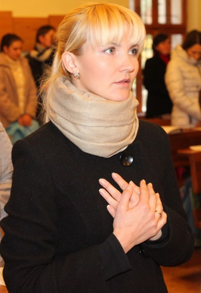 an amazingly tender and charming beautiful young blond Catholic woman in a Church, photo 2