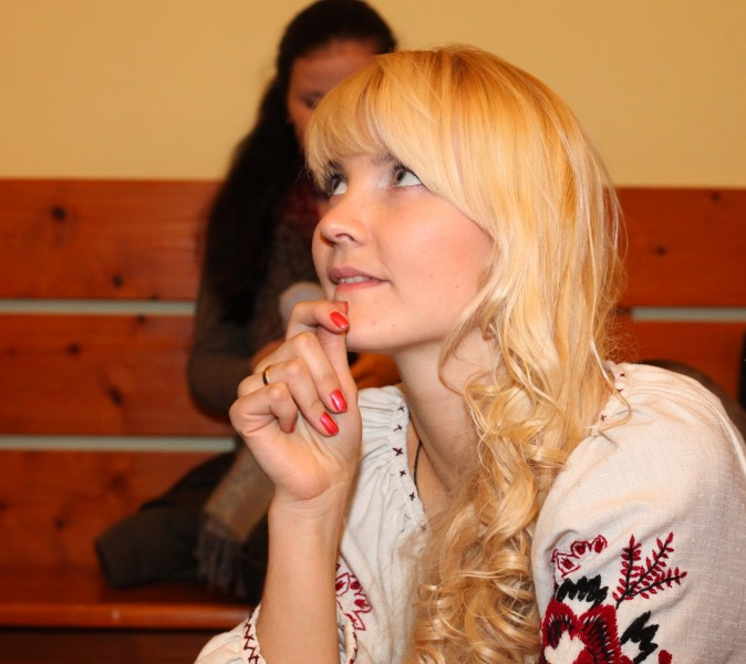 an amazingly tender, feminine and charming, beautiful young blond Catholic woman in a Church, photo 20
