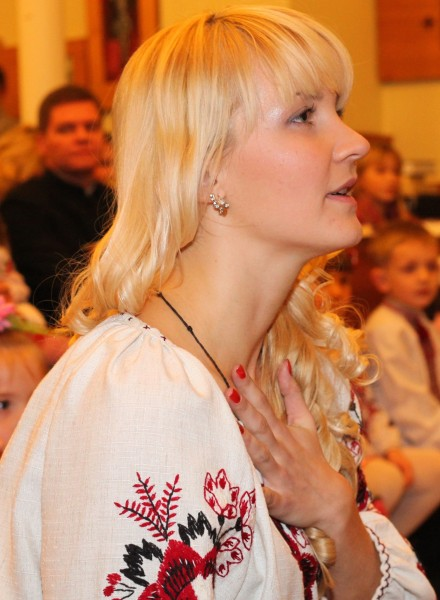 an amazingly tender and charming beautiful young blond Catholic woman in a Church, photo 9
