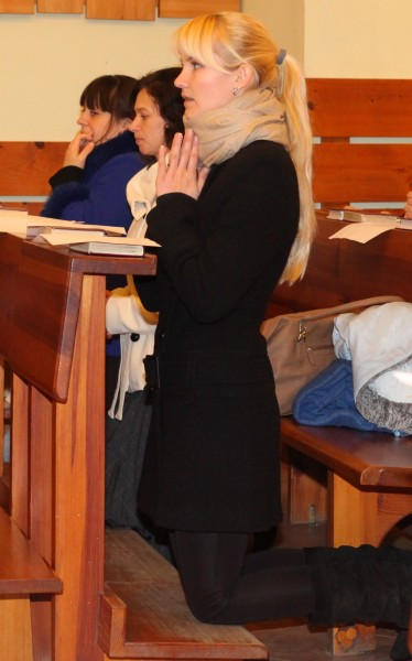 an amazingly tender and charming beautiful young blond Catholic woman praying in a Church, photo 24