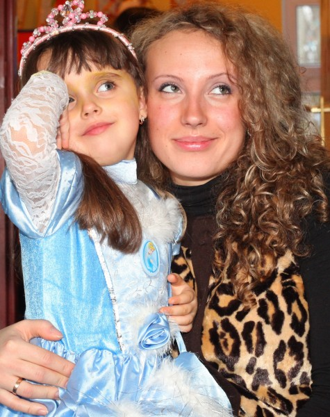 a beautiful curly woman with her daughter in a Catholic kindergarten, picture 6
