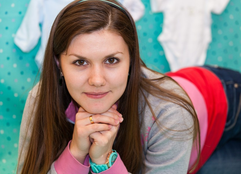 a brunette Catholic young cute woman photographed in April 2014, picture 7/13