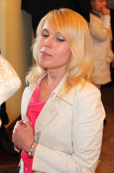 a Catholic woman taking Jesus Christ in a Holy Communion in May 2013, image 2 out of 3
