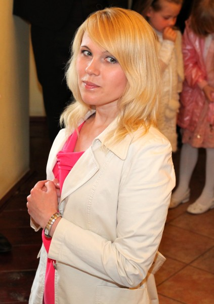 a cute blond Catholic woman taking Jesus Christ in a Holy Communion in May 2013, image 3 out of 3