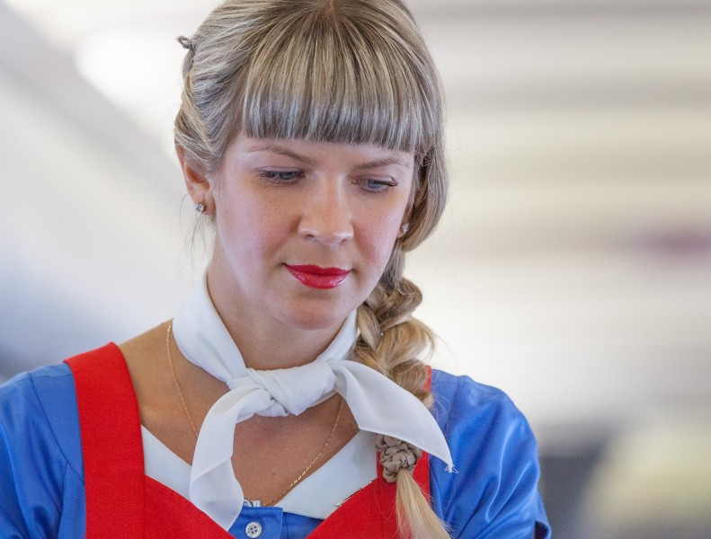 a cute stewardess photographed in August 2014, photo 2/2