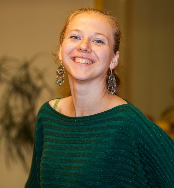 a fair-haired young smiling woman photographed in October 2013, picture 3/6