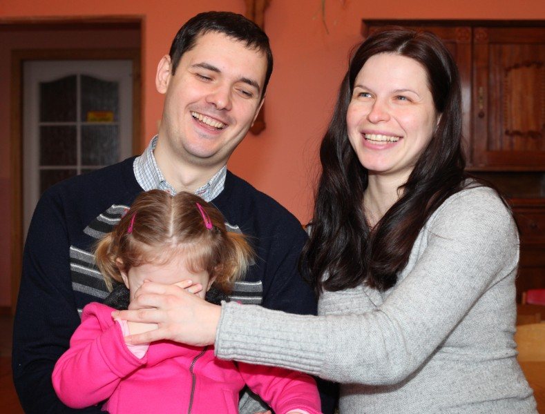 a pregnant beautiful brunette Catholic woman with her husband and daughter, picture 13