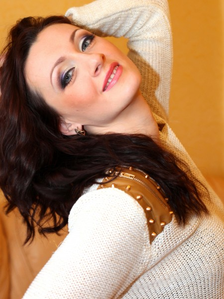 a pretty brunette woman with a heavy makeup, picture 3