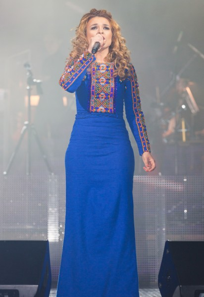 a singer woman performing at her concert in April 2014, photo 14 out of 29