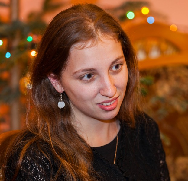 a young attractive Catholic woman photographed in December 2013, portrait 3/4