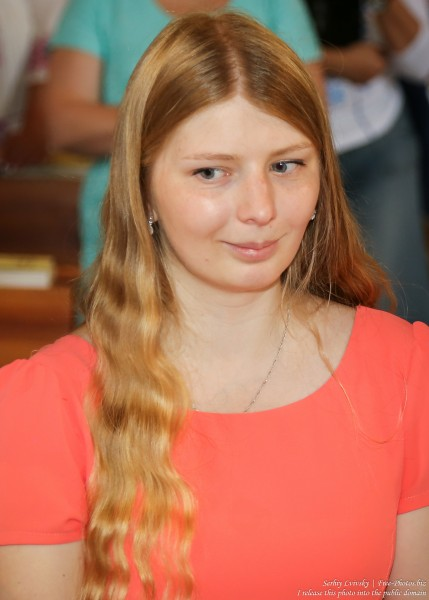 a young blond woman in a Catholic church in July 2016, picture 3