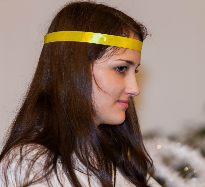 a young brunette Catholic woman in a church photographed in December 2013, picture 5